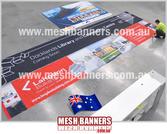 Builders signs on the concrete floor. We make hundreds of fence banner signs and builders signs for designers.