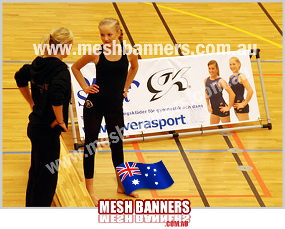 Girls talking with a banner in the background