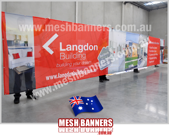 Mesh Banners Factory showing the building company new temporary fence banner sign with house photos, logos and company name