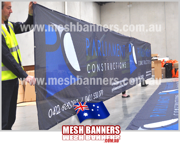 Printed long fencing chainlink privacy screens for construction. Parliment constructions choose mesh banners to surround the construction site.