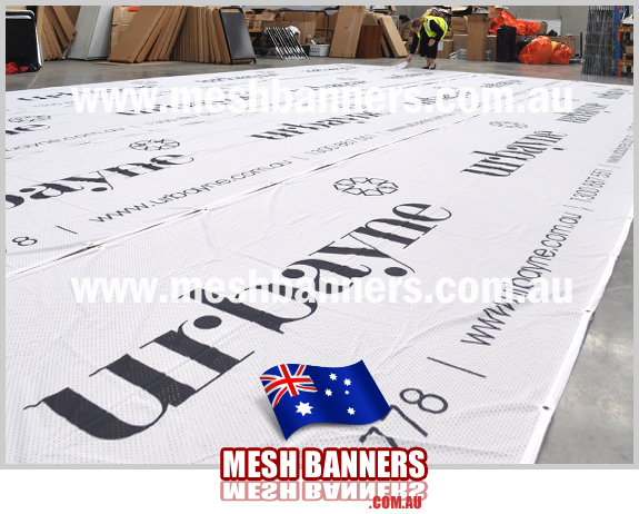 Printed shade netting as used to tie banners onto the construction fence