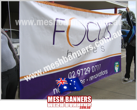 People with temporary fence banner -focus