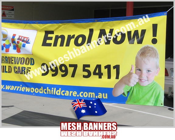 Outdoor banner sign with a childs 'thumbs up'